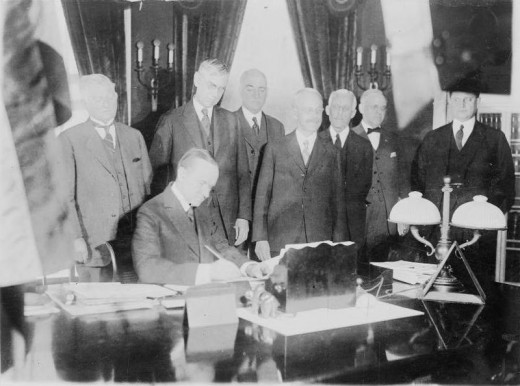 President Calvin Coolidge signing the Revenue Act of 1924