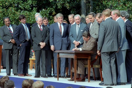 President Reagan signing the Tax Reform Act into law on October 22, 1986