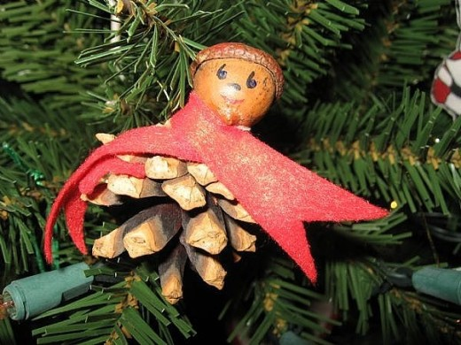 My friend who lives in Maine made this pinecone pixie for me many  years ago. I think fondly of her every year as I hang it on the tree.