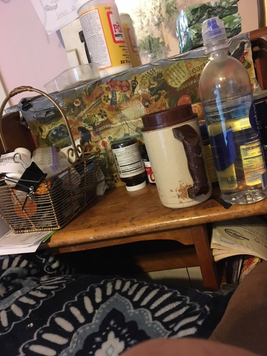 I know my desk is messy, but everything is at my fingertips. Behind the decoupaged divider, are little shelves filled with necessities.