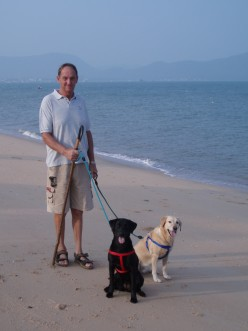 Tessa, Pippa and Derek taking an early morning walk along the beach at Bang Sare, Thailand.