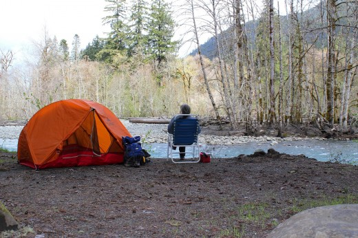 A camp site located next to a lake for fishing enthusiasts.
