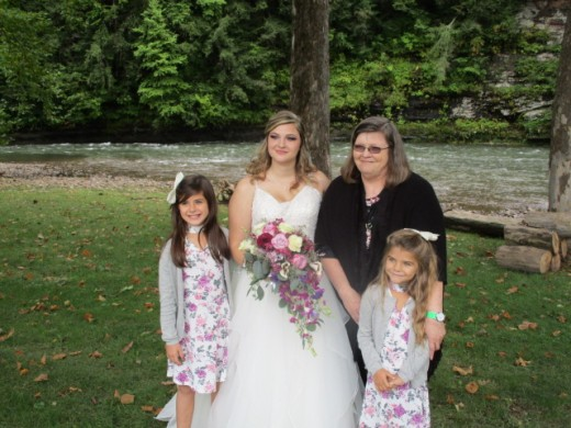This is me at my beautiful granddaughter Emily's wedding. The little girls are my great granddaughters, Braelie and Paisley.