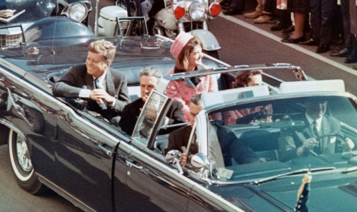 Kennedy in his motorcade in Dallas, seconds before the tragic assassination took place