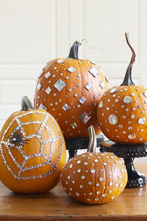 These chic pumpkins catch and reflect the flickers from eerie candlelight.