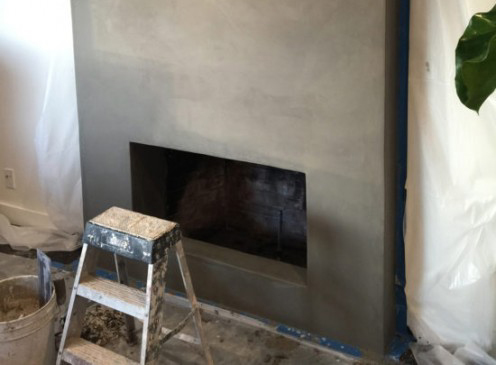This refaced fireplace has no trace of its outdated masonry.