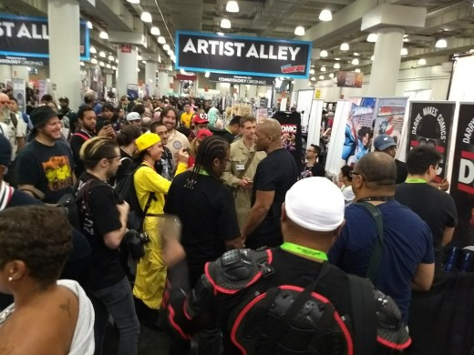 Darryl McDaniels, formerly of the hip hop group Run-DMC, drew a crowd in Artists' Alley, the area of the convention where individual artists promote their own artwork.