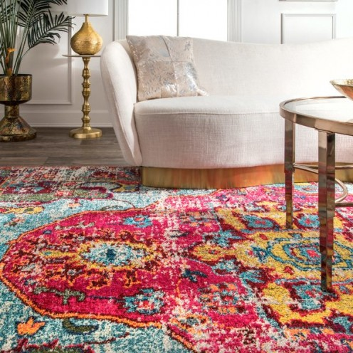 A bright colorful rug is a great way to pull in subtle colors from the room.
