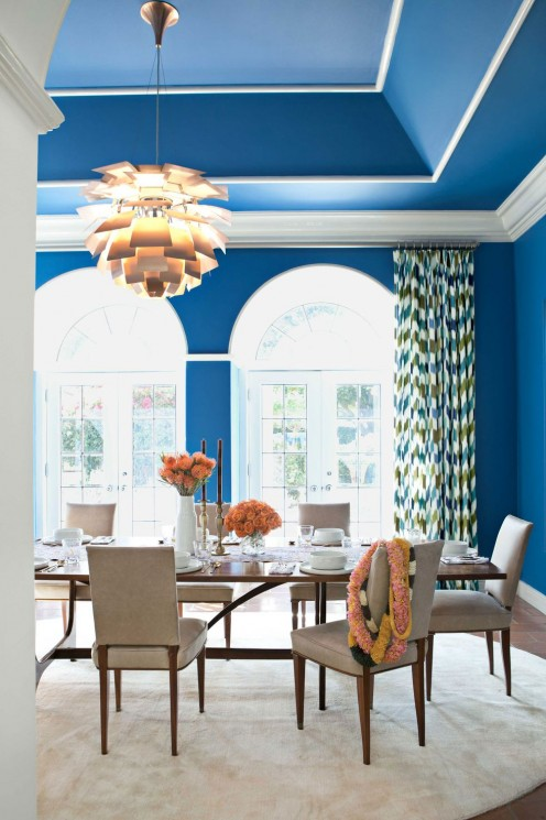The bold blue color on the walls goes right up onto the ceiling.