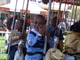 My son, my nephew, and one of my ... nieces smiling for me at the carnival.