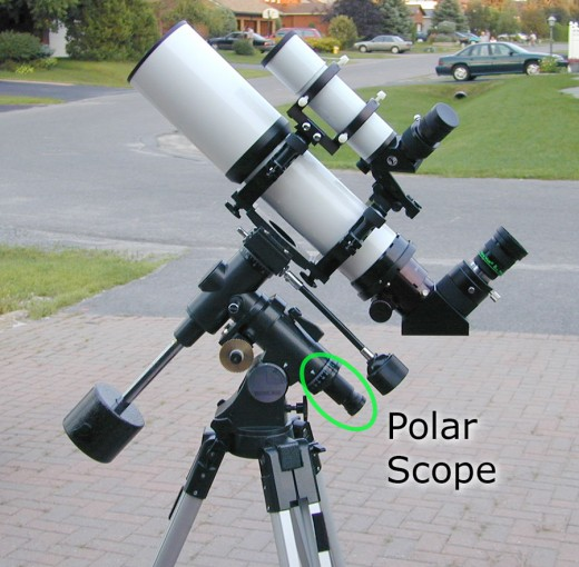 An EQ mount showing the polar scope that helps align with the celestial pole.
