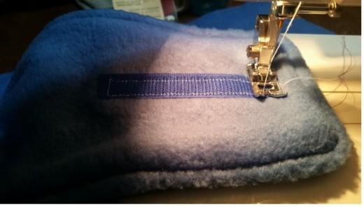 carefully sew around velcro edge