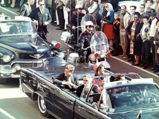 President John F. Kennedy and the First Lady Jackie Kennedy moments before he was mortally wounded by Lee Harvey Oswald.