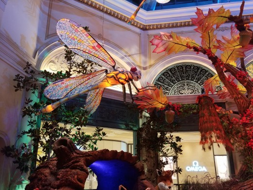 Looking up above the Enchanted Tree, there are giant dragonflies in the air.