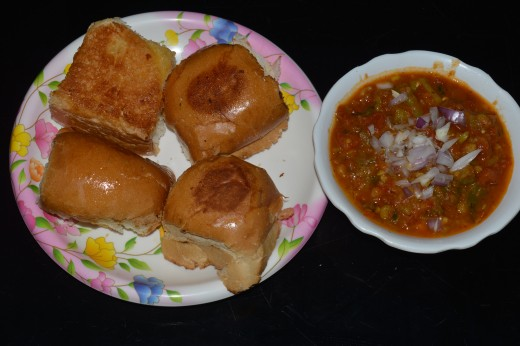 Serve hot Bhaji and Pav buns together. Dunk Pav buns in the Bhaji and enjoy eating!