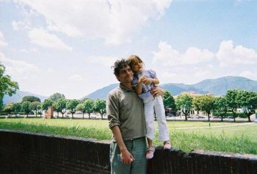 Little Princess and my other half on the Lucca walls with Tuscan mountains on the background