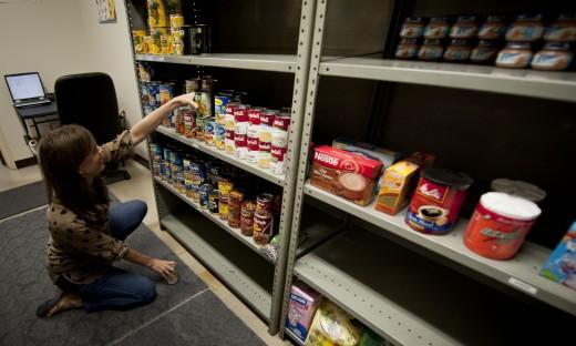 Annie Boerm, Air Force Sergeants Association food bank volunteer, stocks shelves with food Oct. 4, 2012, at Yokota Air Base, Japan.