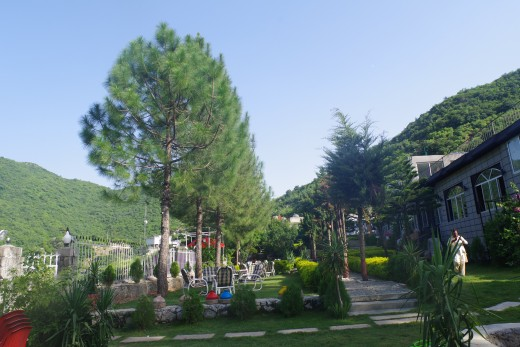 A beautiful hotel near Islamabad with a view of a river and hills on the other side.