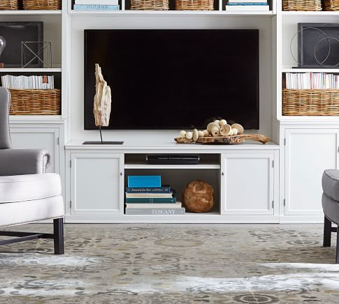 Components can create a stylish media center and a wall of storage.