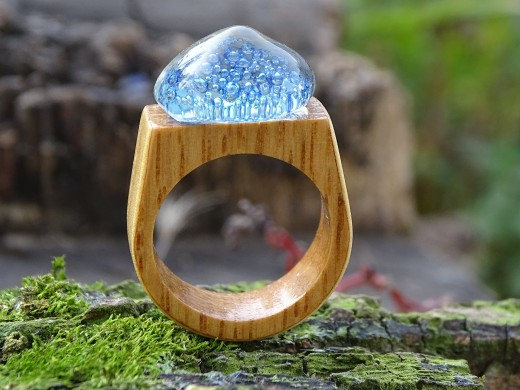 Merging of glass with wood for an interesting finger ring.