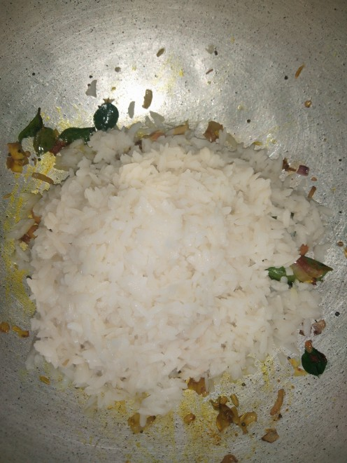 Add flattened rice, mix properly till poha turns to  light yellow color.