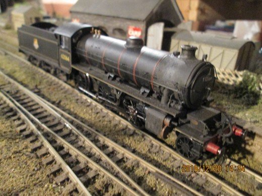 This is one of my two Hornby Class K1 62064 of Stockton-on-Tees (51E) in the early 50s. Some amount of weathering makes a model look real, Smiths three link couplings (on Q6) or Jackson screw couplings and cast brass vac pipes are a must on a K1