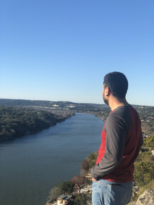 The Top View from Mount Bonnell Austin, where you can see the Colorado River flowing and the beautiful houses next to it.