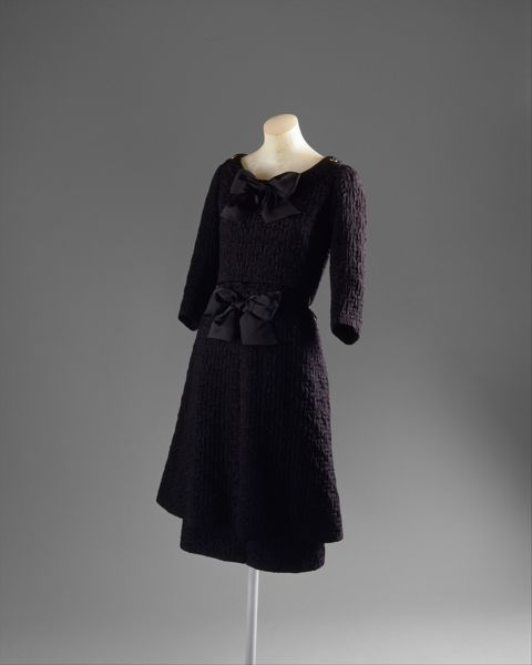 Black Chanel cocktail ensemble, late '60's. The designer was Gabrielle Chanel, and the medium is silk and metal.