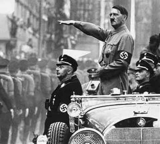 In his presidential automobile with his bodyguard and his vice Himmler