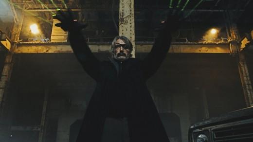 "A one-eyed Mads Mikkelsen as Duncan Vizla in Netflix's action noir film, ""Polar."""
