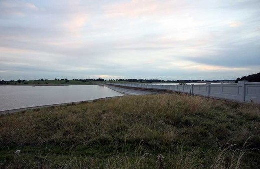 A photograph of Blithfield Reservoir with the causeway clearly seen splitting it into two halves.