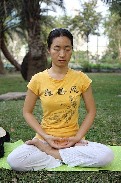 "The legs crossed in the full lotus position, the back and neck straight, and the hands in the ""sacred mudra"" is considered to be the ideal sitting position for maximum relaxation and balance when practising zazen, or sitting meditation"