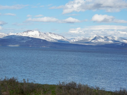 Yellowstone Lake with white-capped mountains in the background