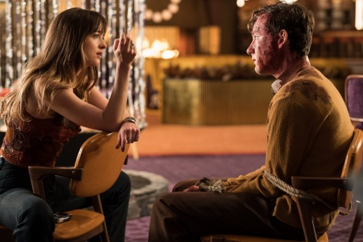 "Dakota Johnson and Lewis Pullman as Emily Summerspring and Miles Miller in, ""Bad Times at the El Royale."""