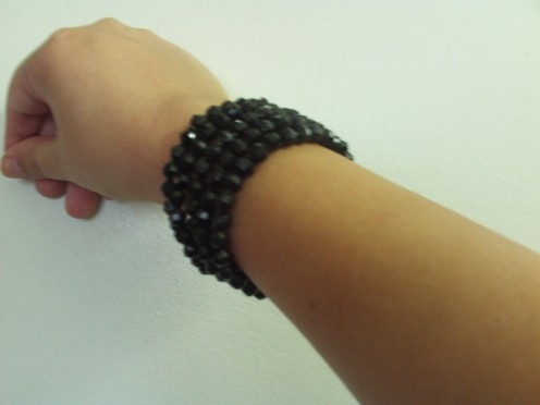 The bracelets look like faux black obsidian.