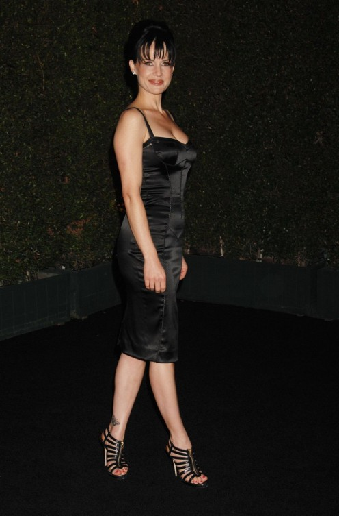 Carla Gugino in a cleavage enhancing black dress and strappy high heels