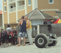 Behind the two men is the booth for Ocean Watersports.  Maybe Josh and Anna wore those lifevests :)...