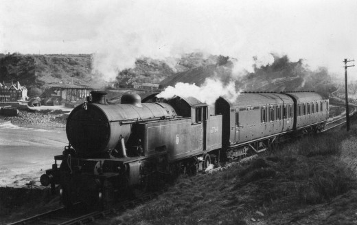 Class L1 2-6-4 T 67764 was a Middlesbrough allocation, seen here leaving Sandsend near Whitby on a northbound working for Teesside with a two coach local working