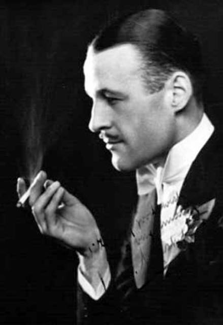 Maskelyne the great illusionist seen in this pre-WWII publicity shot with a lit cigarette