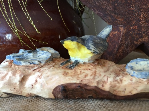My son Cole T. Weih carved his first wren from a chunk of maple he found in my campfire woodpile.
