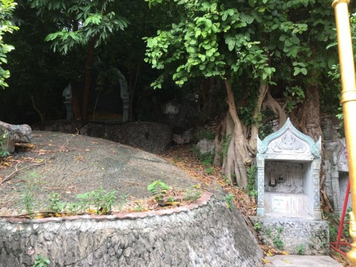The Golden Mount Compound: Secluded area in the compound that has small tombstones and graves