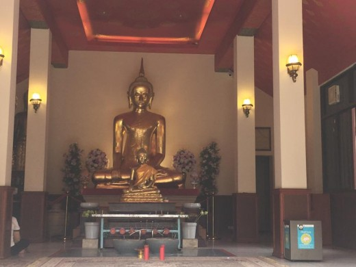 The Golden Mount Compound: A large and mini Golden Buddhas in one of the temples near the back gate