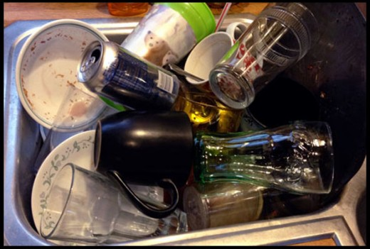 This is an example of how not to fill the sink with dishes.  Why are those aluminum drink cans in there?