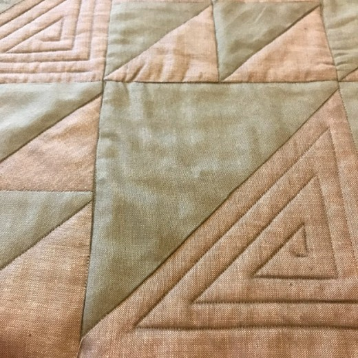 Quilting the three layers together not only forms a warm cover but some fantastic definition!
