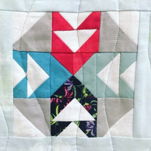 Machine Quilting with a walking foot can create straight lines or gentle waves.