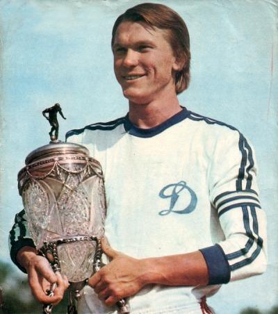 Oleg Blokhin holding a trophy.