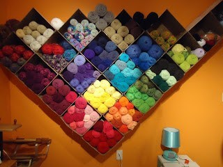 Boxes mounted on your wall are a perfect yarn storage solution.