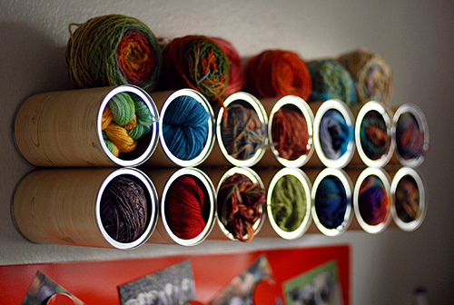 Covered coffee can as a wall rack is a thrifty way to store your skeins of wool