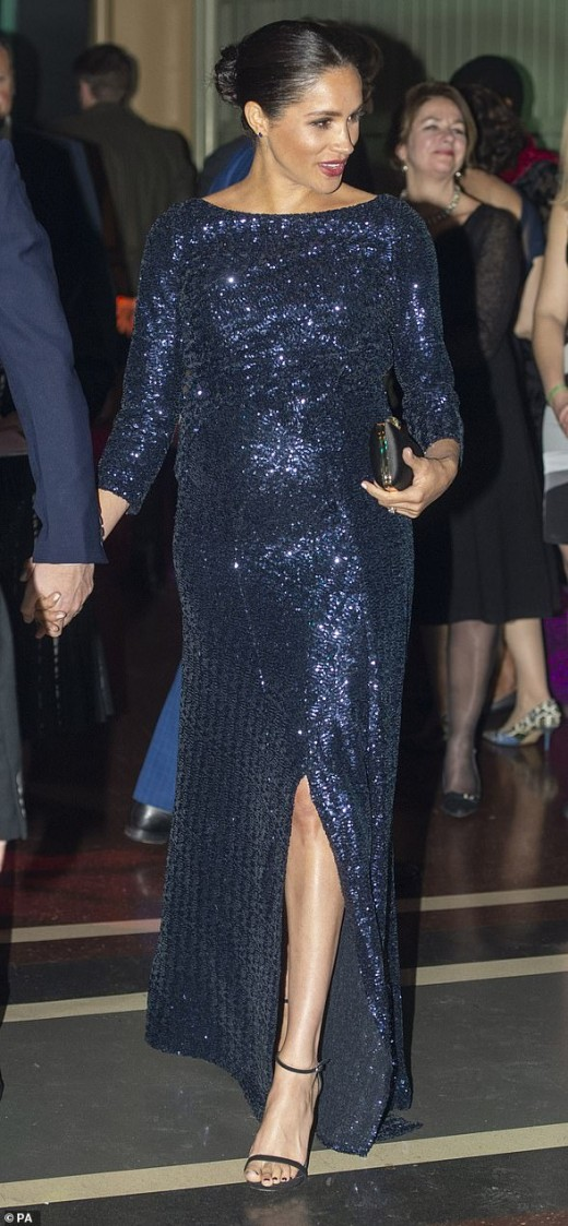 The Duchess of Sussex is pictured in a sparkly Roland Mouret Sarandon Paneled gown worn on January 16 at a Sentebale charity event. Outfit cost was $10,087.