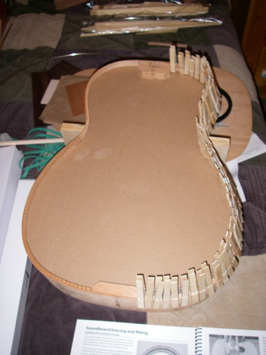 Glued up sides without incident.  I was extremely careful to get everything lined up a perfectly as I could.  They ended up about 1/64 off, but I'm sure than will be corrected later as the soundboard and back are glued up along with the tailpiece and
